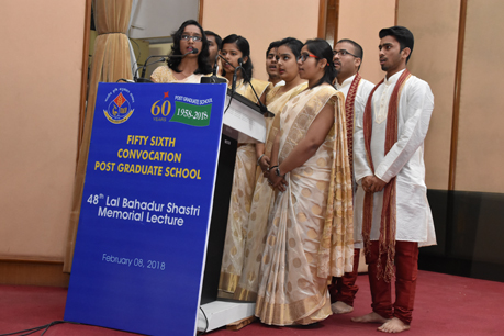 PG School students performing institute song during 48th LBS Lecture.